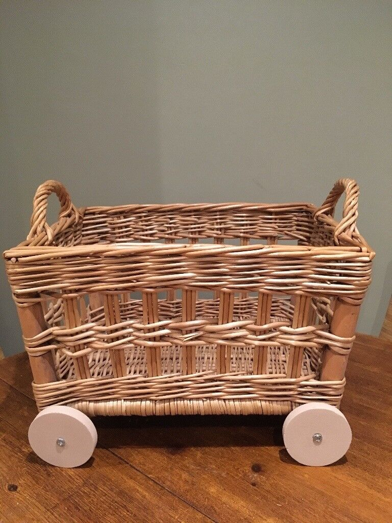 Lovely little toy basket/ storage basket with handles on wheels