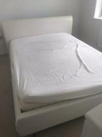 White king size faux leather bed