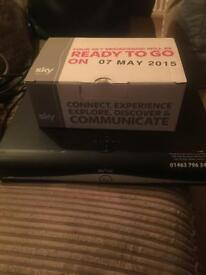 Sky Box with remote control and router. Broadband router is brand new and never used.