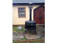 Bespoke handcrafted outdoor log burner. Fully painted