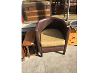 Tub chair , in brown leather . Good quality and condition . Must be seen , heavy chair .