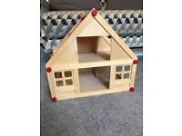 Little wooden dolls house