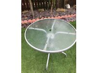 Glass top patio table, 4 chairs & umbrella