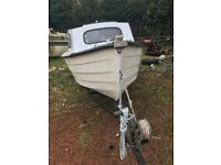 Mayland Fishing Boat with Johnson Seahorse outboard with tank.