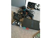 PS2 working condition with over 30 great games, 2 microphones, 2 memory cards, 3 controllers