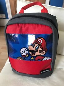 3ds with mario bag and games
