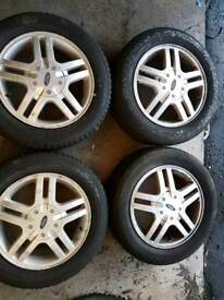 Ford 4 stud alloys and tyres.