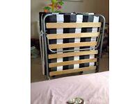 2 x folding single guest beds
