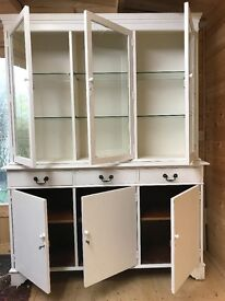 Glass fronted display cabinet with drawers and cupboards.