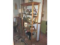 Solid pine shelving unit with bottom drawer
