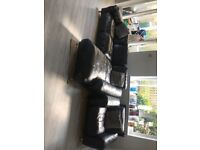 Black leather L shaped sofa and armchair