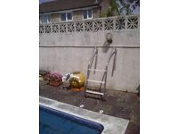 Swimming pool ladder and sand filter