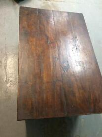 Very old, solid wood coffee table.