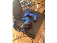 500gb smooth black PlayStation 4 with blue controller and blue/black turtle beach headset