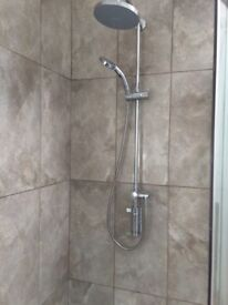 Wall mounted twin shower with over head