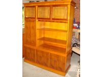 A two piece storage and display unit in excellent condition. Yew wood .