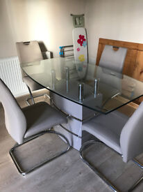 Brand NEW dining table and 4 chairs - DFS Piatto