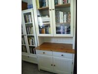 A tall pine and white painted wood dresser unit with glass doors.
