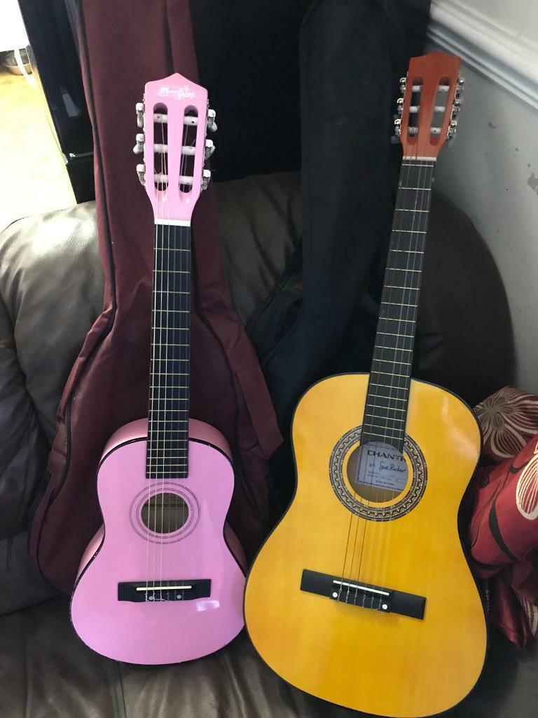 1/2 (pink) and 3/4 guitars with case