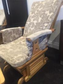 Rocking / gliding chair with rocking footstool