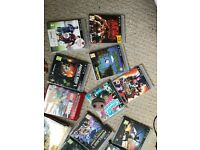 PlayStation 3 with box and games
