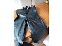 Rukka motorcycle waterproof trousers.