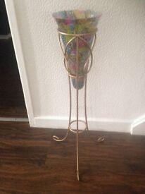 Beautiful tall glass vase on tripod stand