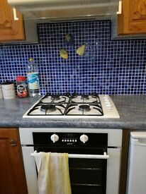 Kitchen cupboards, sink and taps, and oven and hob and extractor
