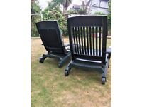 A pair of garden loungers in good condition, plus cushions.