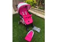 Obaby pink cottage rose pushchair