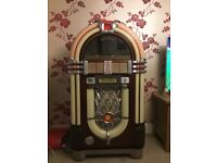 Wurlitzer one more time jukebox with surround sound speakers