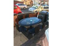 Lovely glass dining table with 6 leather chairs