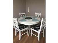 White painted wooden dinning table and 4 chairs.