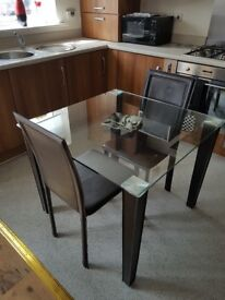 SMALL GLASS DINING TABLE AND 2 CHAIRS EXC COND.