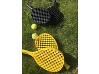 Two pairs hard racquets and tennis balls
