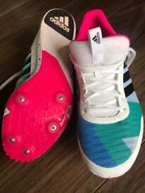 Adidas track spikes.