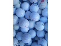 Various brands of golf balls