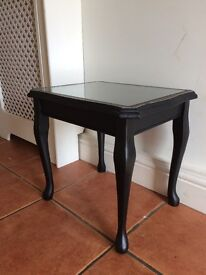 Black & gold wooden coffee table with faux leather & glass top