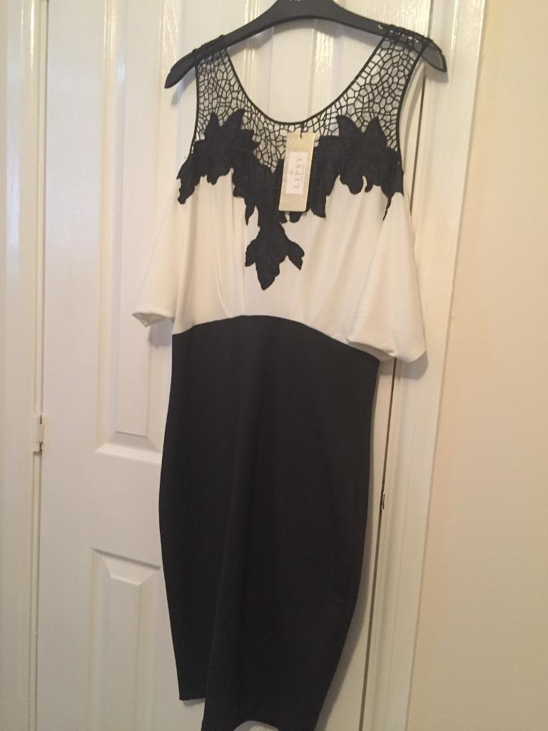 Lipsy Dress Size 14in Killingworth, Tyne and WearGumtree - Black and white Lipsy dress with sleeve and cut out shoulder design, new with label attached. Originally price £55.00