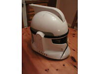 Star wars Trooper Helmet would suit child of about 5 to 7 years old.