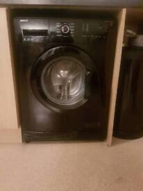 SLEEK BLACK WASHING MACHINE BROUGHT FOR 250 ONLY WANT 110 O.N.O