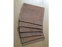 Six seagrass/rattan place mats