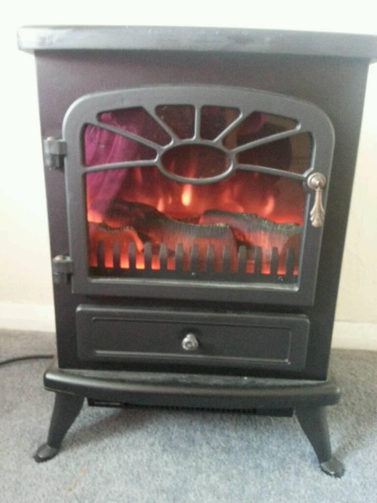 Electric log effect fan fire