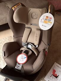 Cybex Sirona car seat. New with tags, includes new beige/chocolate & black covers. Retails at £400.