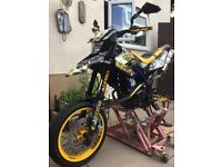 heres my wr125 x lots of extras real eye catcher to much to put down feel free to ask any questions