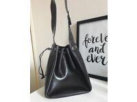 Lancaster Paris designer brown handbag