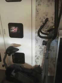 Exercise bike with cross trainer