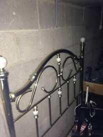 Double brass headboard