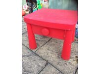 Child's red IKEA table with drawer