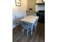 Stripped pine farmhouse table and four chairs fully refurbished